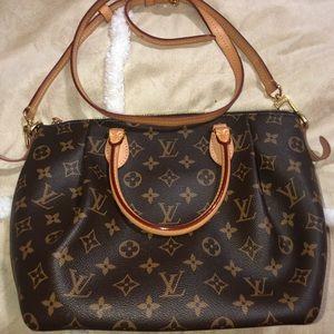 Louis Vuitton cross over & handbag